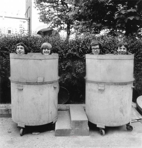 The Ingoes band members popping up out of industrial bins